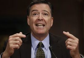 FBI Director James Comey testifying before Congress.