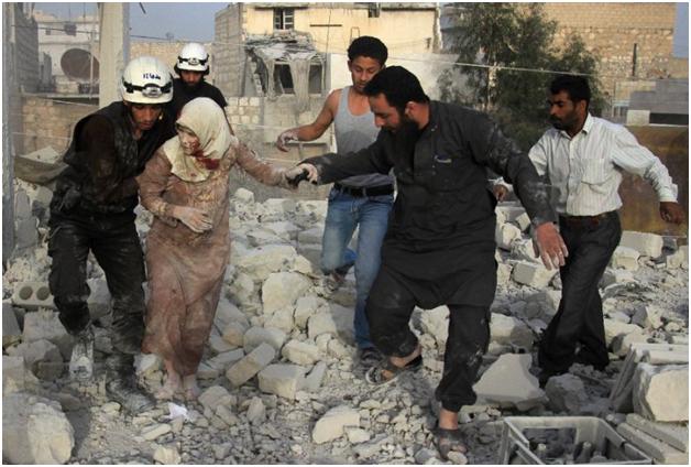 Rescue of victim of Assad regime bombing, Aleppo, Syria, April 11, 2016