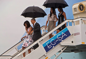 US President Barack Obama (2nd L), First Lady Michelle Obama (L) and daughters Malia (2nd R) and Sasha (R) disembark from Air Force One at the Jose Marti International Airport in Havana on March 20, 2016. Obama arrived in Cuba to bury the hatchet in a more than half-century-long Cold War conflict that turned the communist island and its giant neighbor into bitter enemies. AFP PHOTO/Nicholas KAMM / AFP / NICHOLAS KAMM (Photo credit should read NICHOLAS KAMM/AFP/Getty Images)